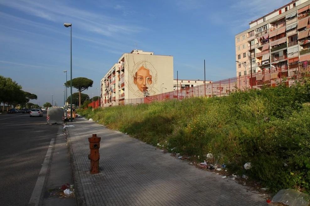 Tutti i bambini delle periferie: il nuovo murales di Jorit Agoch
